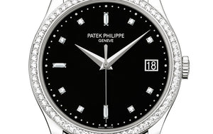 Patek Philippe 5297G-001 features date display, black dial, Diamond indexes and Dauphine hands