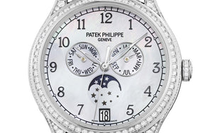 Patek Philippe 4948G-010 features white dial, mother of pearl material, Arabic numerals indexes and Feuille hands