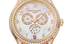 Patek Philippe 4948R-001 features white dial, arabic numerals indexes and Feuille hands