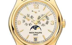 Patek Philippe 5146J-001 features cream dial, mixed indexes and Feuille hands