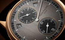 Load image into Gallery viewer, Patek Philippe 5235/50R-001 features grey dial, mixed indexes and stick hands