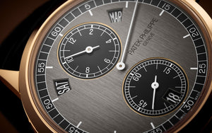 Patek Philippe 5235/50R-001 features grey dial, mixed indexes and stick hands