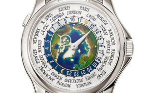 Patek Philippe 5131/1P-001 features silver dial with Enamel material, Arabic numeral indexes and Proprietary hands