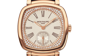 Patek Philippe 7041R-001 features silver dial, Roman numerals indexes, Feuille hands