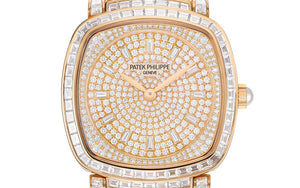 Patek Philippe 7042/100R-010 is paved with 251 diamonds and 12 trapeze-cut diamond hour markers and 18K gold dial plate
