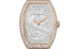 Patek Philippe 7099R-001 features hand-guilloched gold dial set with 367 diamonds
