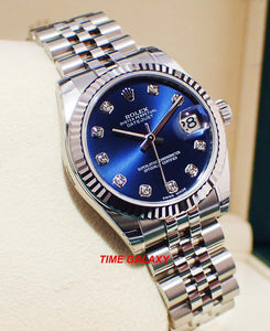 Rolex 178274-0048 features blue dial, diamond indexes and fluted