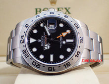 Load image into Gallery viewer, Rolex 216570-0002 features black dial with arrow shaped 24 hour hand and hour markers in Chromalight