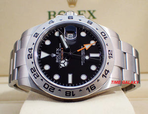 Rolex 216570-0002 features black dial with arrow shaped 24 hour hand and hour markers in Chromalight
