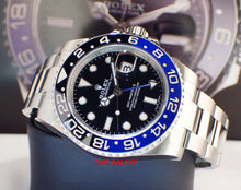 Load image into Gallery viewer, Rolex 116710blnr-0002 features black dial, black and blue Cerachrom bezel