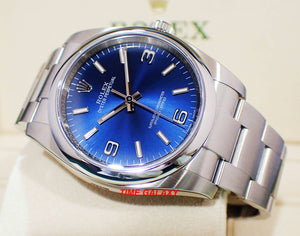 Rolex 116000-0002 features sunburst blue dial
