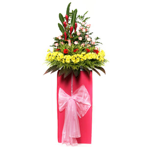 Gerbera daisies, Roses and ginger flowers arranged on a box stand for grand opening and congratulatory occasions by Katong Flower Shop for Singapore Delivery.