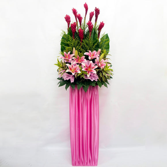 Lilies and ginger flowers arranged on a box stand for grand opening and congratulatory occasions by Katong Flower Shop for Singapore Delivery.
