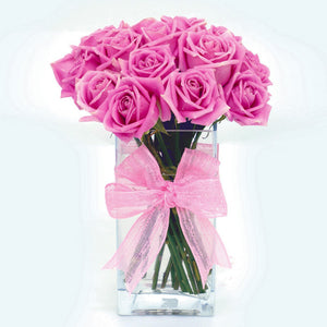 18 pink roses in glass vase table arrangement by Katong Flower Shop for Singapore Delivery.
