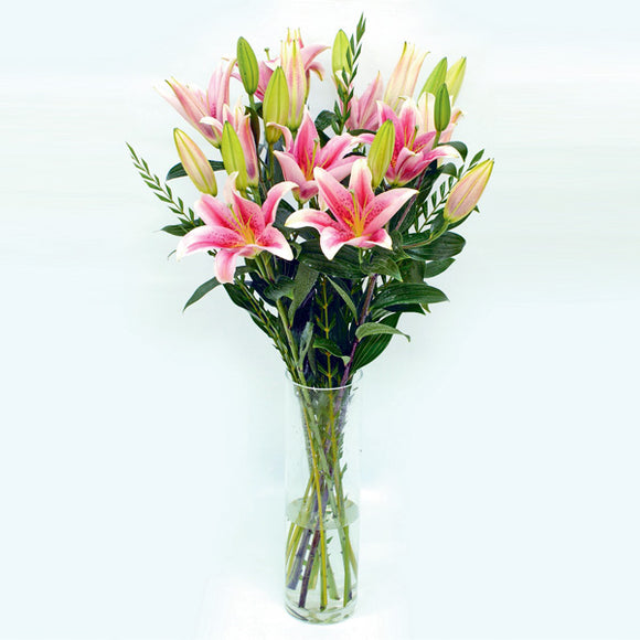 Lilies in a glass vase by Katong Flower Shop for Singapore Delivery. Table flower arrangement
