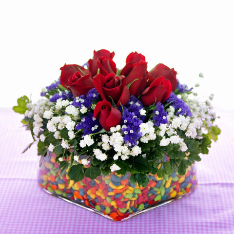 KFA015 | Red roses in vase filled with colored pebbles | Katong Flower Shop