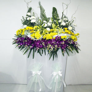 Yellow gerbera daisies, yellow and white chrysanthemum, lilies and purple orchids Funeral condolence wreath by Katong Flower Shop for Singapore Delivery
