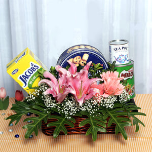 A gift hamper wellness basket with healthy food and flowers by Katong Flower Shop for singapore delivery.