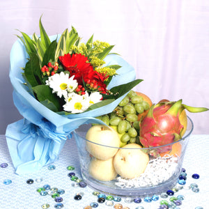 A sweet gift hamper of fruits accompanied with a surprise floral bouquet of designer's choice, by Katong Flower Shop for Singapore Delivery