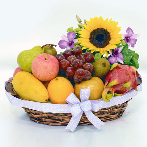 A cute fruit get well basket with sunflower by Katong Flower Shop for Singapore delivery