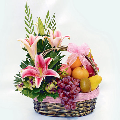 A floral fruit get well basket by Katong Flower Shop for Singapore Free Delivery. Tropical fruit with lilies and other filler flowers.