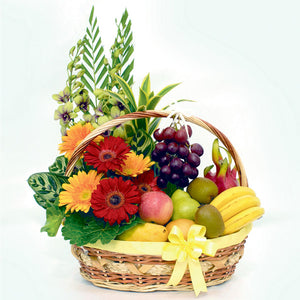 A sumptuous floral fruit basket with a ribbon for get well occasions by Katong Flower Shop for Singapore delivery