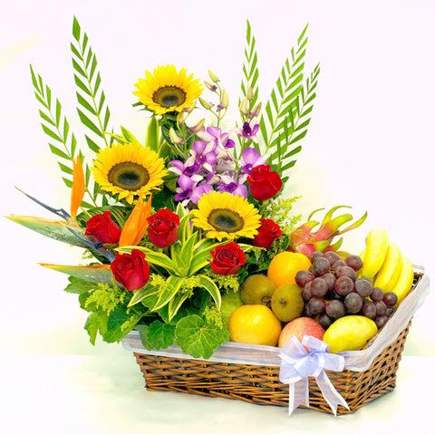 A luxurious basket of beautiful sunflower, roses and orchids as well as tropical fruits by Katong Flower Shop for Singapore Delivery