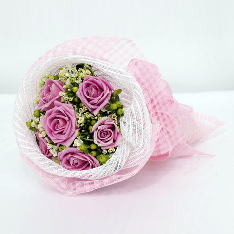 12 pink rose bouquet with filler flowers by Katong Flower Shop with free delivery to the whole of Singapore