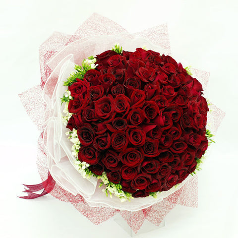 99 red rose bouquet with filler flowers by Katong Flower Shop with free delivery to the whole of Singapore