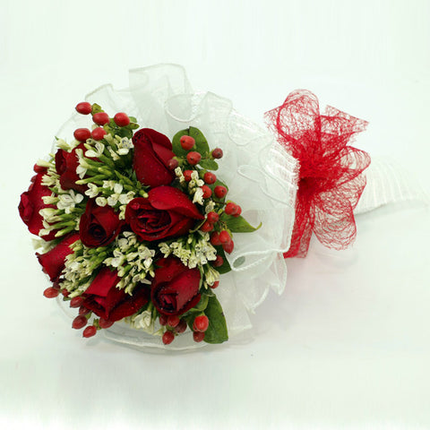 10 red rose bouquet with filler flowers by Katong Flower Shop with free delivery to the whole of Singapore