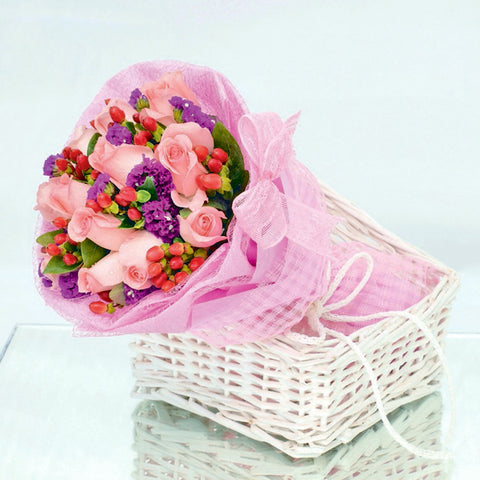 12 peach rose bouquet with filler flowers by Katong Flower Shop with free delivery to the whole of Singapore
