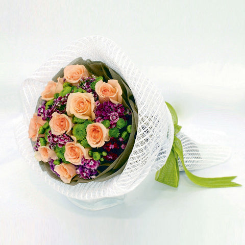 10 champagne rose bouquet with filler flowers by Katong Flower Shop with free delivery to the whole of Singapore
