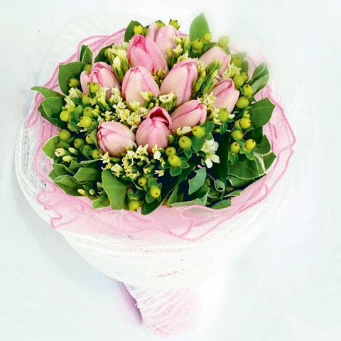 10 pink tulips bouquet with filler flowers by Katong Flower Shop with free delivery to the whole of Singapore