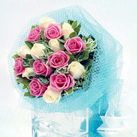 16 mixed rose bouquet with filler flowers by Katong Flower Shop with free delivery to the whole of Singapore
