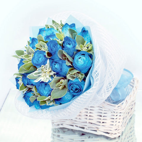 18 Blue rose bouquet with filler flowers by Katong Flower Shop with free delivery to the whole of Singapore