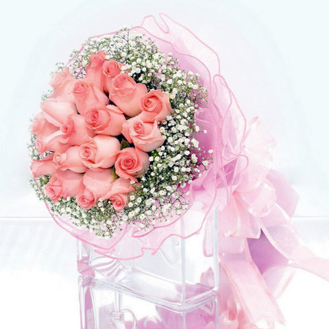 20 peach rose bouquet with filler flowers by Katong Flower Shop with free delivery to the whole of Singapore