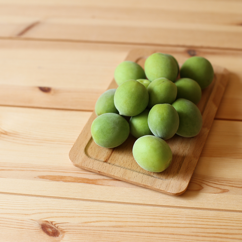 Korean green apricots also called maesil, ume, or green plums
