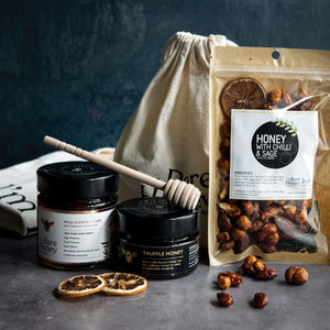 Limited edition festive pack with black truffle infused honey and hand cut honeycomb