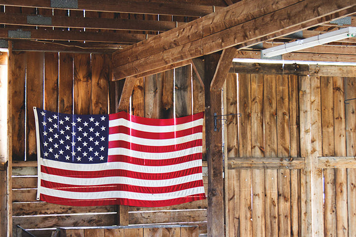 American flag hanging in a wooden barn