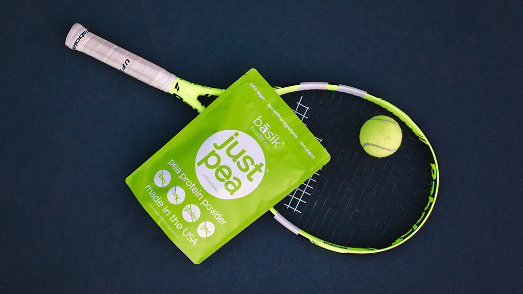 JustPea pea protein powder with a tennis racket and ball
