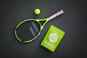 JustPea pea protein powder with tennis racket and ball