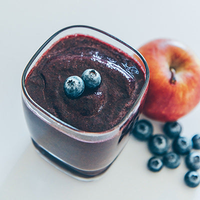 Purple blueberry smoothie in glass