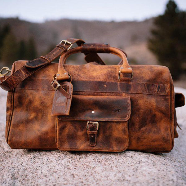Men's Buffalo Leather Duffel Bag - Weekend Bag for Travel front view on rock