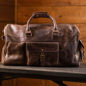 Men's Buffalo Leather Duffel Bag - Weekend Bag for Travel  On Table