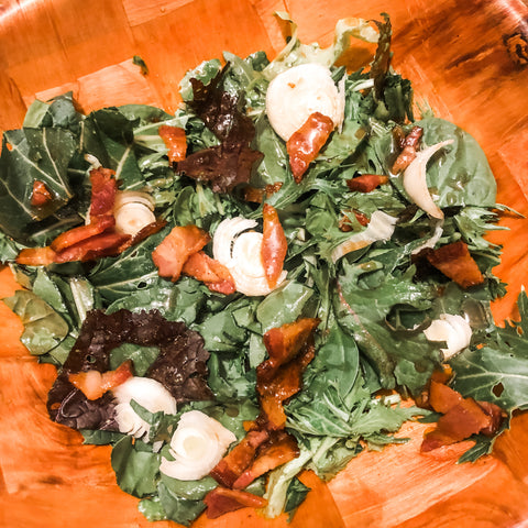Wilted salad with hot Bacon vinaigrette