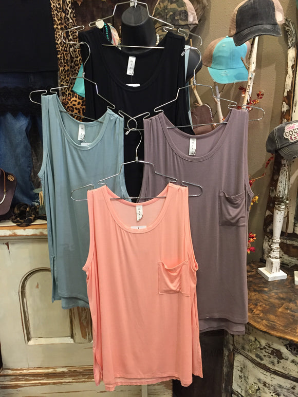 SLEEVELESS POCKET TOP IN BLACK, TAUPE AND SAGE.