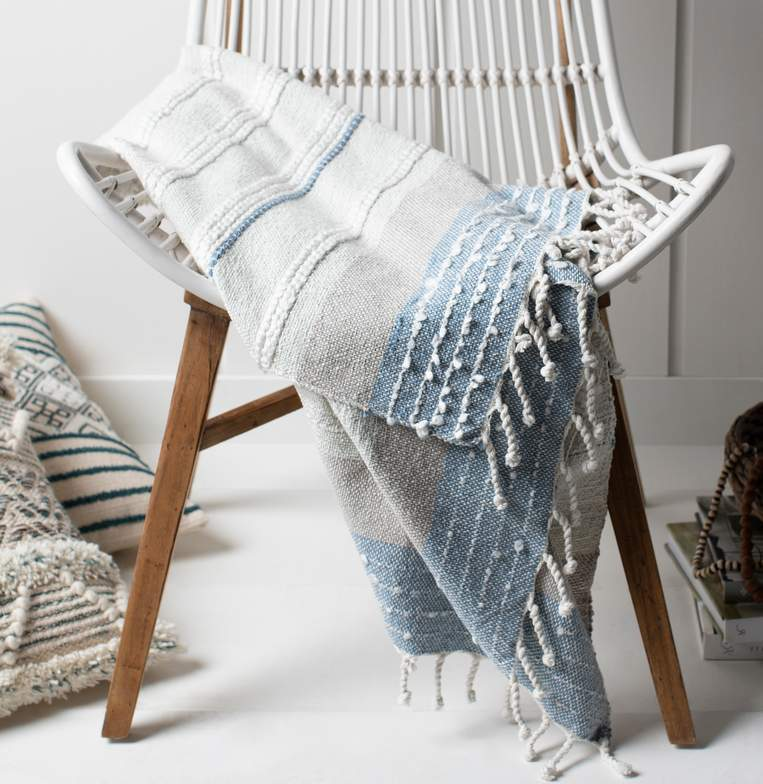 cream white and blue striped throw blanket with tassels
