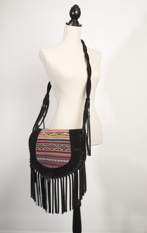 traditional textile and black suede handbag
