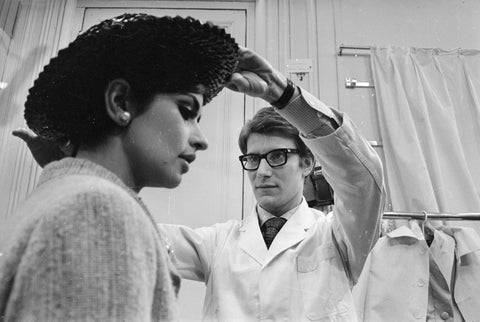 A young Yves Saint Laurent seen in his own fashion house in Paris / Credit: Getty Images