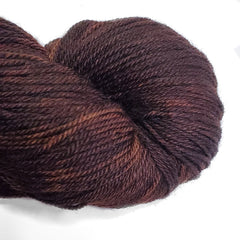 A closeup of a rich brown skein of yarn.